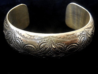 NAVAJO DOMED HOLLOW CUFF with traditional stamped symbols in